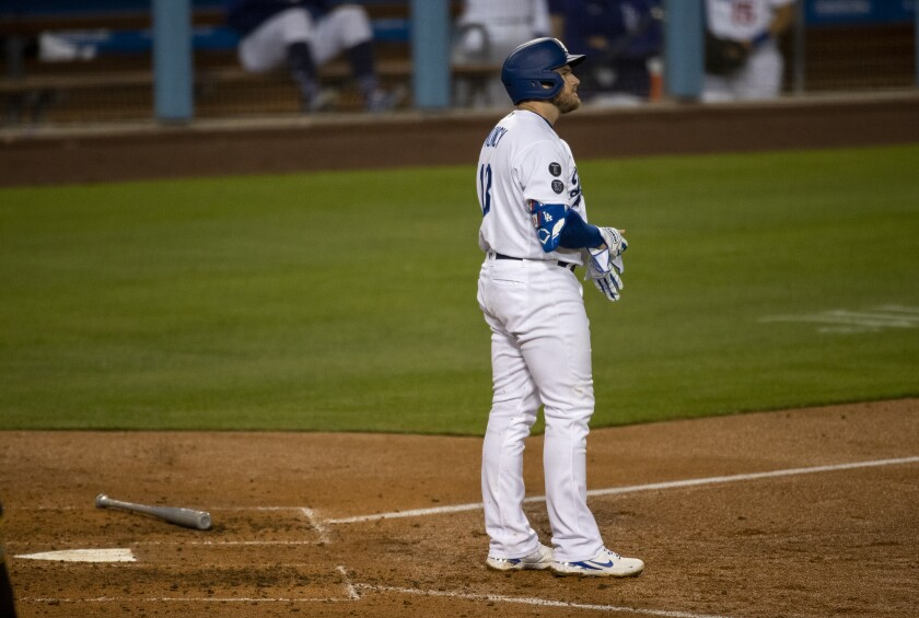 Dodgers first baseman Max Muncy stands at home plate after striking out.