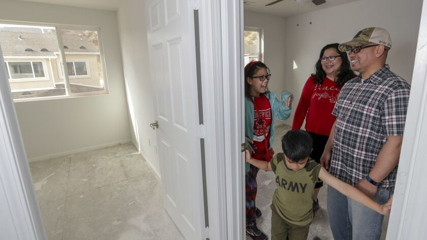 Iraq war veterans Marlon and Josette Tolentino, with their children Rinnah, 14, and Marcus, 6, check out their future home in a community of single-family houses built in Santa Clarita for veterans and service members.