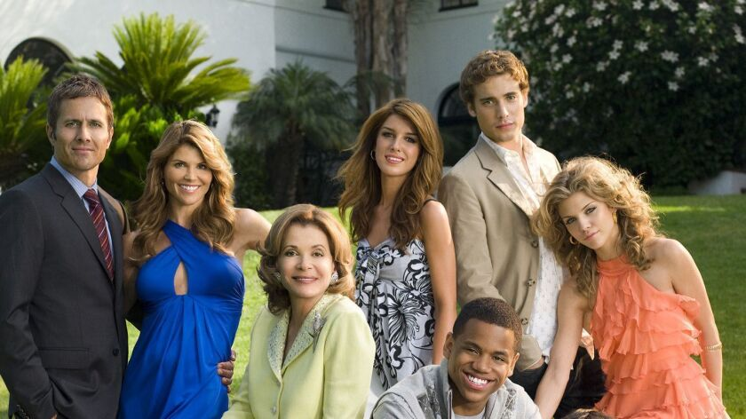 """In this image released by The CW network, the cast from""""90210"""", front row from left, Ryan Eggold as"""