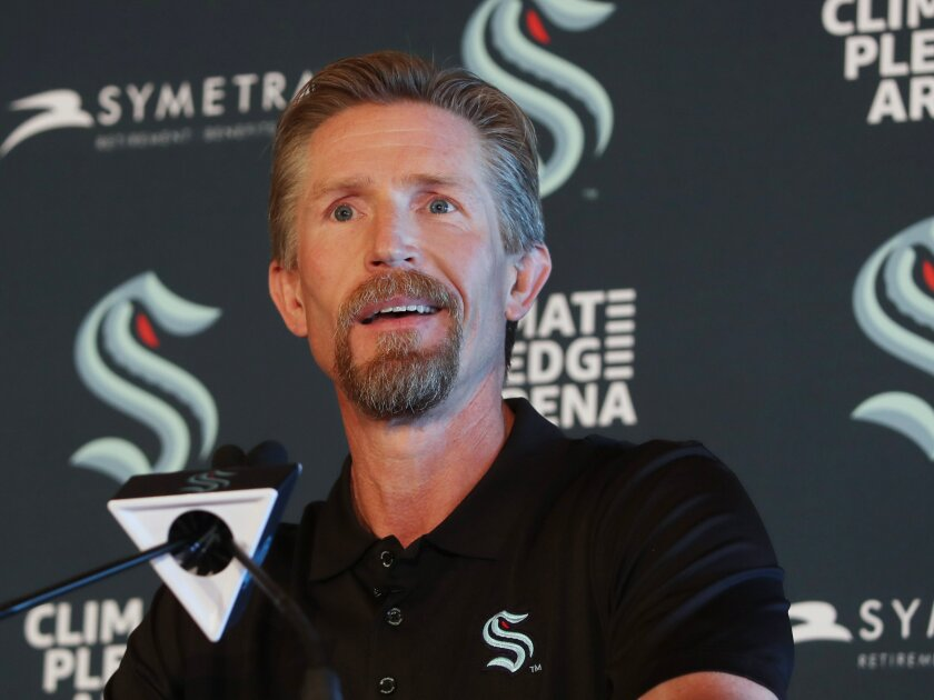New Seattle Kraken Head Coach Dave Hakstol listens during a news conference, Thursday, June, 24, 2021 in Seattle. The Kraken hired Hakstol as head coach of the expansion franchise that will begin its first NHL hockey season in the fall. It's his second NHL head-coaching job after three plus seasons with the Philadelphia Flyers from 2015-19. (Ken Lambert/The Seattle Times via AP)
