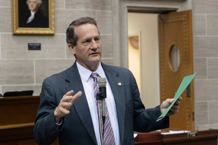"""In this Feb. 3, 2016 photo provided by the Missouri House of Representatives, Missouri state Rep. Don Gosen, R-Chesterfield, speaks on the House floor in Jefferson City, Mo.  Gosen abruptly resigned from the Missouri House on Wednesday, Feb. 17, citing rumors about """"some personal issues"""" as he beca"""