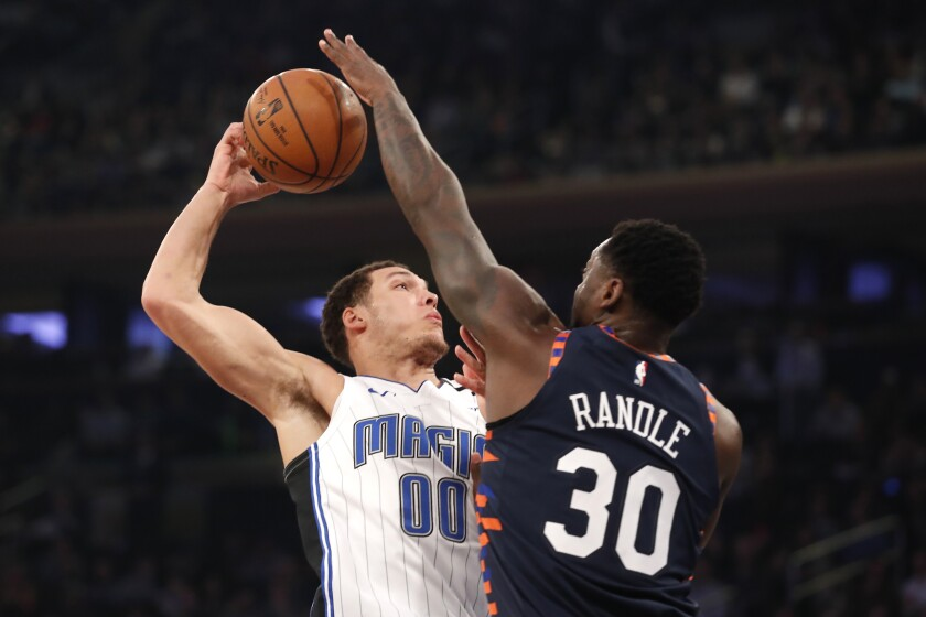 New York Knicks forward Julius Randle (30) blocks the shot of Orlando Magic forward Aaron Gordon (00) during the first half of an NBA basketball game, Thursday, Feb. 6, 2020, in New York. (AP Photo/Michael Owens)