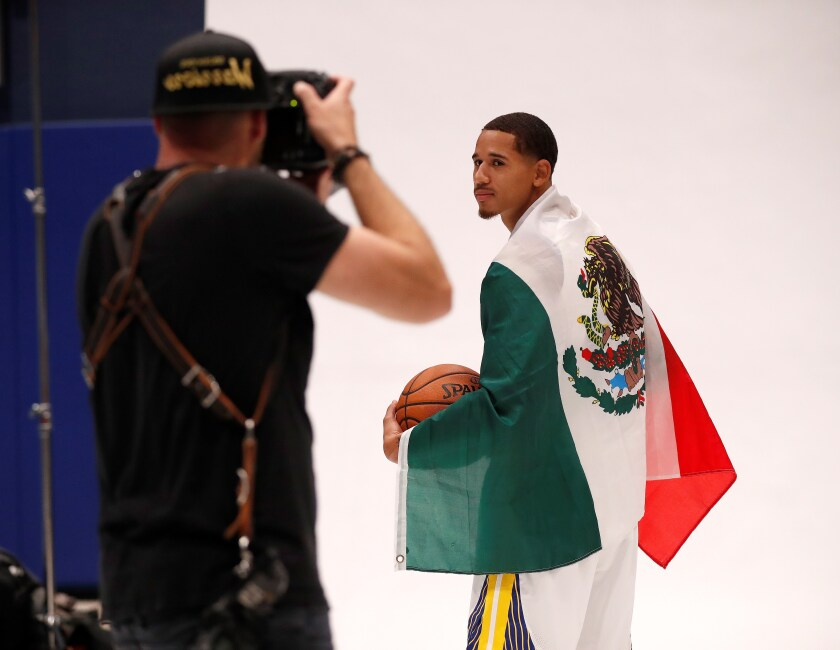 Golden State Warriors Juan Toscano-Anderson poses with the Mexican flag