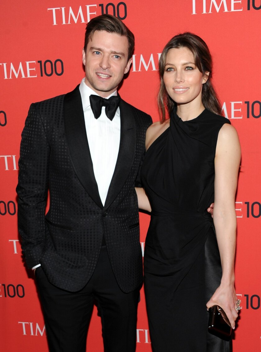 FILE - In this Tuesday April 23, 2013 file photo, actor and singer Justin Timberlake and wife, actress Jessica Biel, attend the TIME 100 Gala in New York. Timberlake shared a picture of a bulging belly - presumably belonging to wife - on Instagram on Saturday, Jan. 31, 2015, his 34th birthday. He w