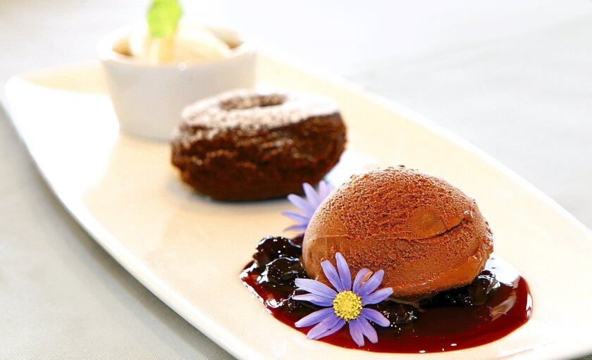 Three Tastes dessert platter with Hazelnut Pot de Crème, Gingerbread Donut, and Chocolate Cherry Ice Cream is a sweet-and-satisfying ending to a fine meal at The Shores restaurant in La Jolla. Photo by Daniel K. Lew