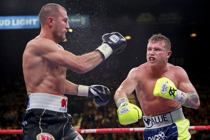 Canelo Alvarez, right, and Sergey Kovalev exchange punches during their light-heavyweight WBO title bout Saturday night in Las Vegas.