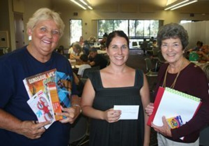 Randa Krackow, left, and Susan Pfleeger, right, recently made a donation to Casa de Amistad Program Director Nicole Mione-Green in honor of their friend Leona Shaw.