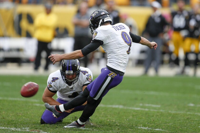 Baltimore Ravens kicker Justin Tucker (9) kicks a field goal as Sam Koch (4) holds to defeat the Pittsburgh Steelers in overtime of an NFL football game, Sunday, Oct. 6, 2019, in Pittsburgh. The Ravens won 26-23. (AP Photo/Don Wright)