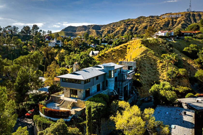 Thick granite walls connect the past to the present at our rebuilt Home of the Week in Hollywood Hills.