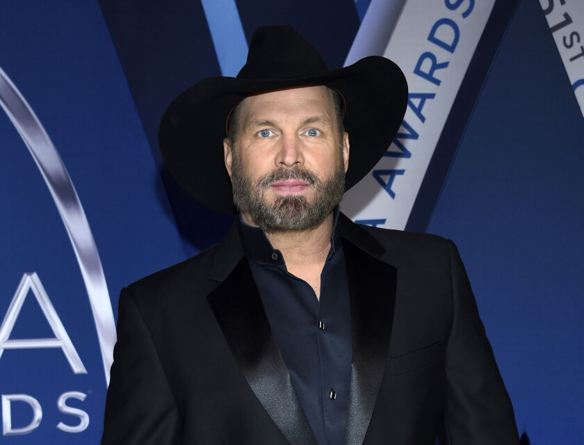 """FILE - This Nov. 8, 2017 file photo shows Garth Brooks at the 51st annual CMA Awards in Nashville, Tenn. Brooks, whose hits include """"Friends in Low Places,"""" and """"The Thunder Rolls,"""" will receive the Library of Congress Gershwin Prize for Popular Song in March 2020. (Photo by Evan Agostini/Invision/AP, File)"""