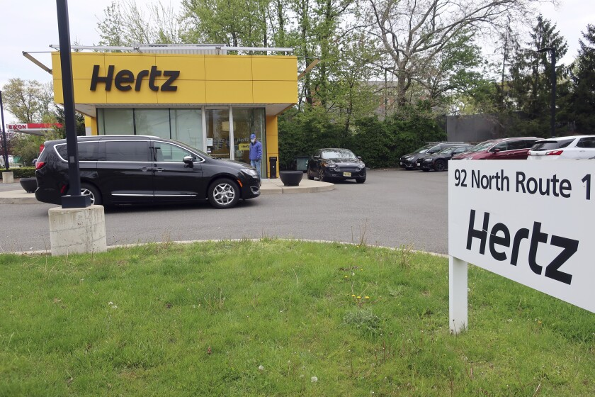 FILE - In this May 6, 2020, file photo, a Hertz car rental is closed during the coronavirus pandemic in Paramus, N.J. A bankruptcy court has confirmed Hertz's reorganization plan, Thursday, June 10, 2021, which helps clear the way for the car rental company to emerge from Chapter 11 bankruptcy protection by the end of the month. (AP Photo/Ted Shaffrey, File)