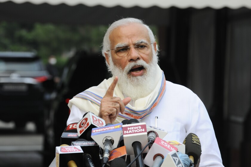 Indian Prime Minister Narendra Modi addresses the media as he arrives at the Parliament in New Delhi, India, Monday, Sept.14, 2020. Indian lawmakers have returned to Parliament after more than five months even as coronavirus cases continue to surge at the fastest pace than anywhere else in the world. (AP Photo)