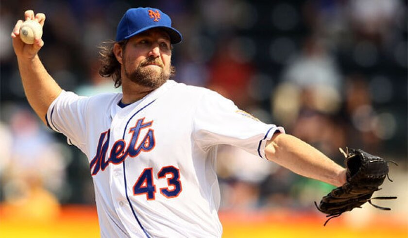 Mets pitcher R.A. Dickey became the first pitcher who relies primarily on the knuckleball to ever win the Cy Young Award on Wednesday.