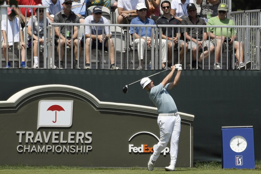 Chez Reavie hits off the first tee during the final round of 2019's Travelers Championship golf tournament in Cromwell, Conn.