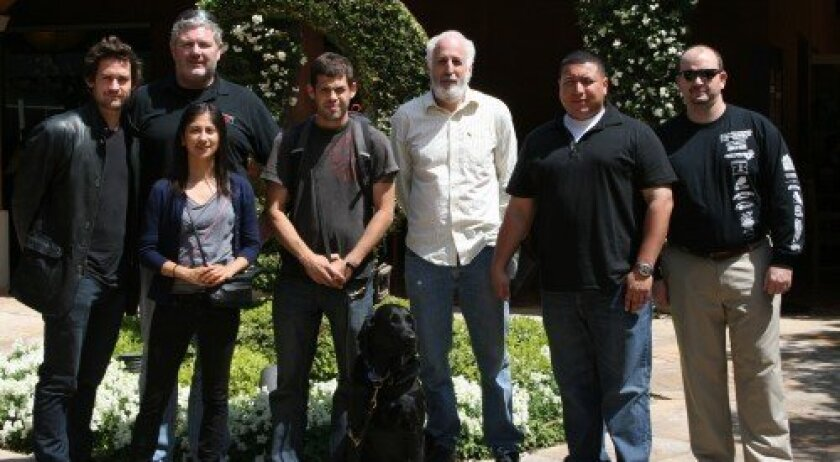 Veterans 360 founder and executive director Rick Collins, second from left, on an outing with young veterans in Los Angeles, where they met actor Hugh Dancy, far left.
