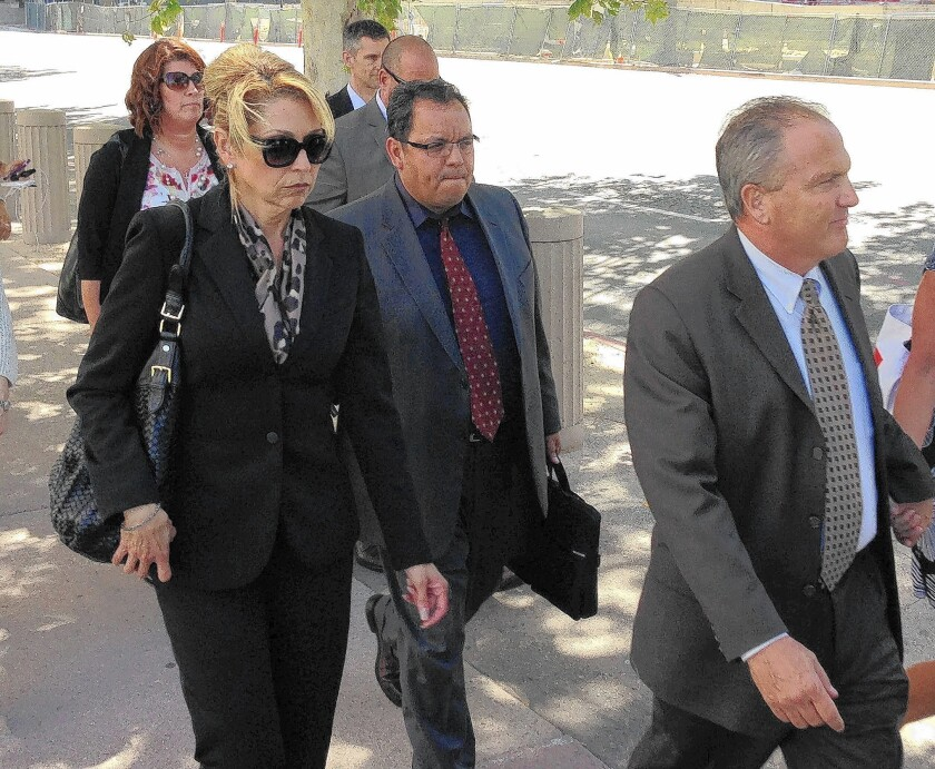 Sgt. Maricela Long, left, and Lt. Stephen Leavins, far right, leave the federal courthouse after sentencing Tuesday. Long got 24 months and Leavins 41 months.