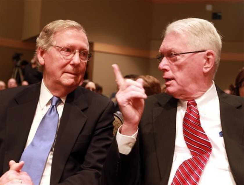Former Sen. Jim Bunning, right, talks with U.S. Senate, Republican Leader Mitch McConnell, R-Ky., in a theater at Northern Kentucky University where McConnell gave a lecture on Bunning's career Friday, Sept. 6, 2013, in Highland Heights, Ky. Some three years after helping to push the baseball Hall-of-Famer out of the U.S. Senate, McConnell is singing Bunning's praises as a political leader who wasn't afraid to stand up for his beliefs in Washington, even when it meant standing alone. (AP Photo/