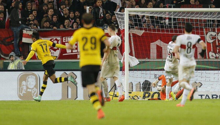 Dortmund's Pierre-Emerick Aubameyang, left, has scored his side's second goal during a quarterfinal match of the German soccer cup between VfB Stuttgart and Borussia Dortmund in Stuttgart, Germany, Tuesday, Feb. 9, 2016. (AP Photo/Michael Probst)