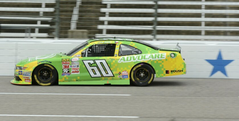 Chris Buescher drives during NASCAR Xfinity auto race practice at Texas Motor Speedway, Friday, Nov. 6, 2015, in Fort Worth, Texas. (AP Photo/Larry Papke)