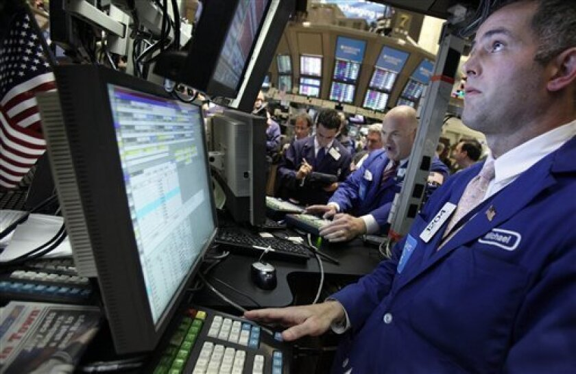 In this Sept. 30, 2010 photo, specialists Evan Solomon, second from right, and Michael Volpe, right, work at their posts on the floor of the New York Stock Exchange, in New York. Stock futures are rising Friday, Oct. 1, as signs of strong manufacturing growth in China is driving stocks higher worldwide.(AP Photo/Richard Drew)