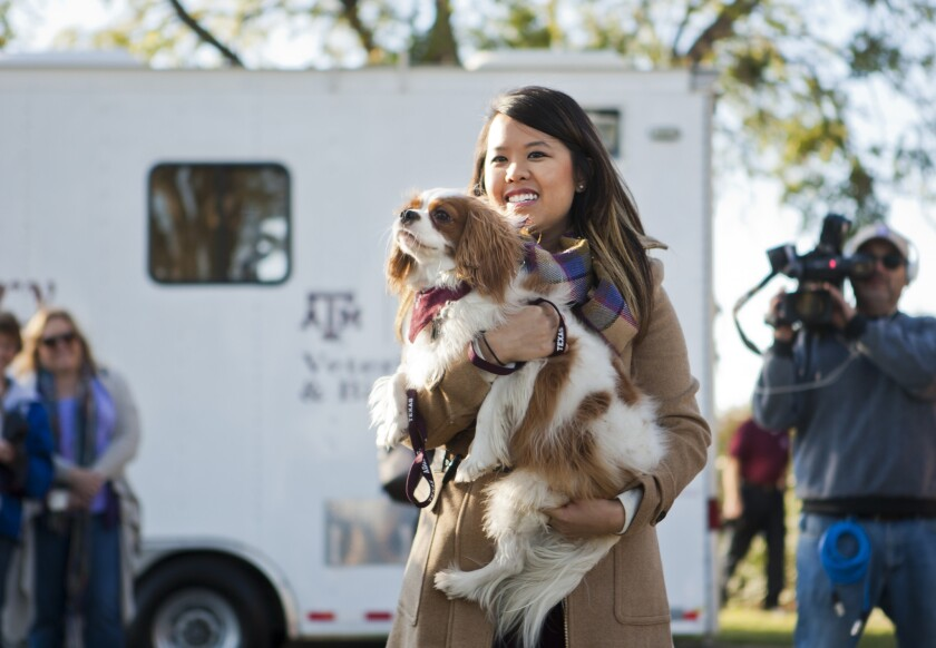 Nurse Nina Pham is reunited with her dog Bentley