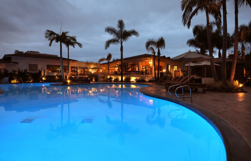 Dusk view of the pool at the Four Season Residence Club. Across the pool is the bar, restaurant and Driftwood spa.