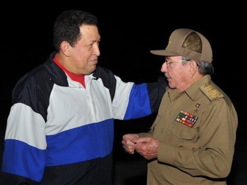 In this picture released Tuesday, Dec. 11, 2012 by Cuba's state newspaper Granma, Cuba's President Raul Castro, right, receives Venezuela's President Hugo Chavez at the Jose Marti International airport in Havana, Cuba, Monday, Dec. 10, 2012. Chavez arrived in Cuba on Monday for a fourth cancer-related operation after designating the vice president as his political heir. (AP Photo/Granma)