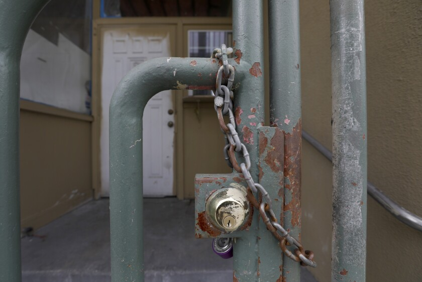 A lock on a gate at the building formerly known as the Royal Park Motel in Los Angeles on March 20.