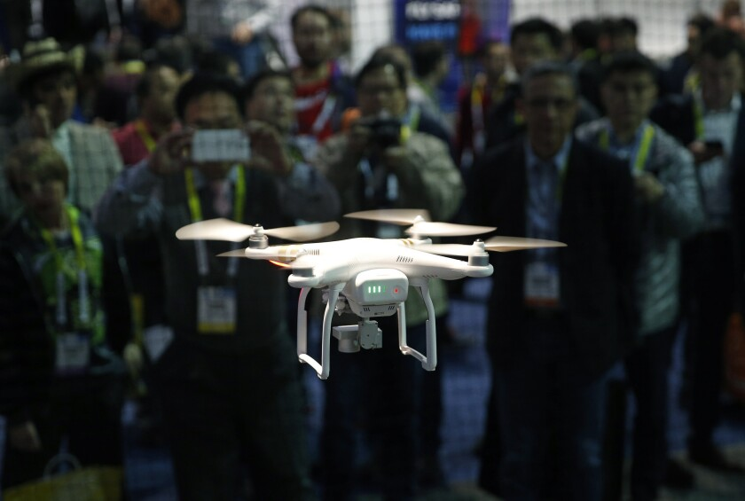 A drone hovers at the DJI booth during CES International on Jan. 7, 2016, in Las Vegas.
