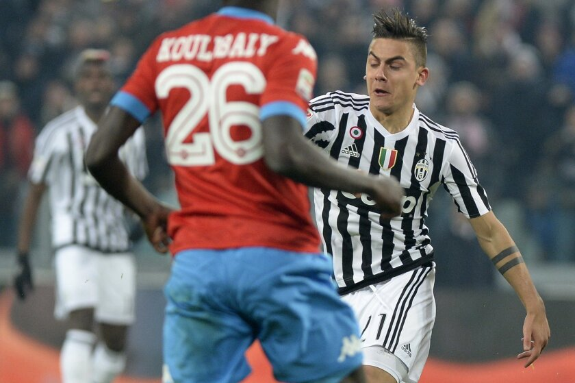 Juventus' Paulo Dybala, right, challenges for the ball with Napoli's Kalidou Koulibaly during a Serie A soccer match between Juventus and Napoli at the Juventus stadium, in Turin, Italy, Saturday, Feb. 13, 2016. (AP Photo/Massimo Pinca)