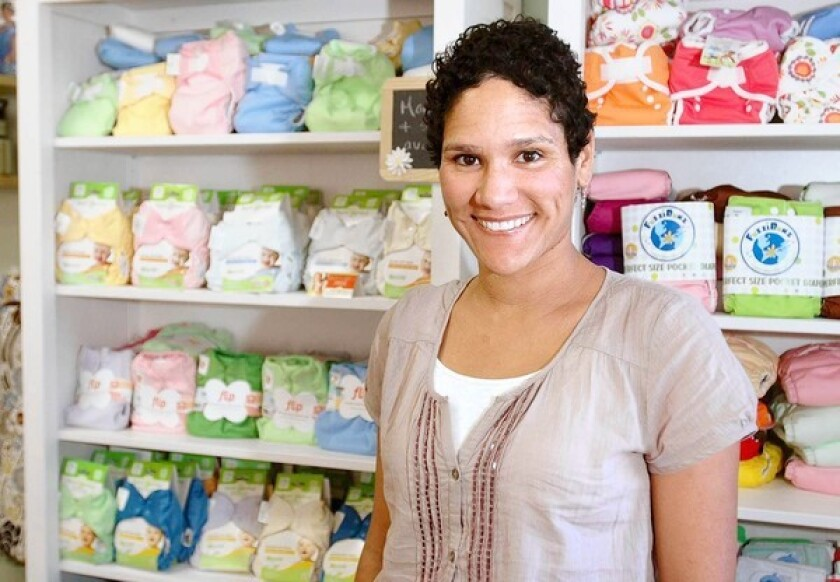 Giselle Baturay in front of a selection of cloth diapers in her shop Granola Babies, a natural baby boutique in Costa Mesa.