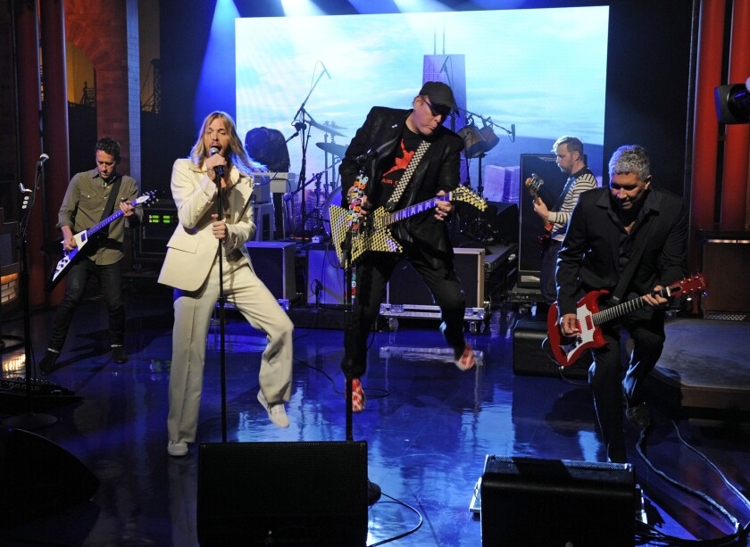 Musical guests Foo Fighters perform with special guest Rick Nielsen on the Late Show with David Letterman, Thursday Oct. 16, 2014. The band will appear on David Letterman's final late-night show.