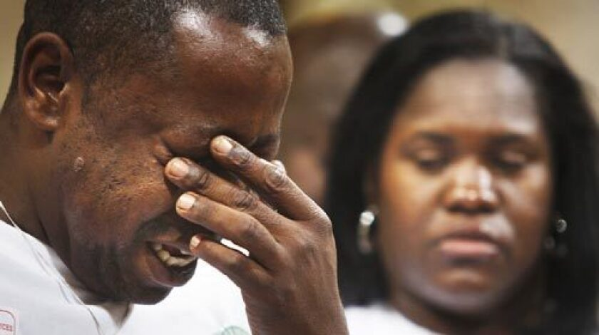 Jamiel Shaw Sr. weeps while standing with his wife Anita Shaw before the Los Angeles City Council Tuesday.