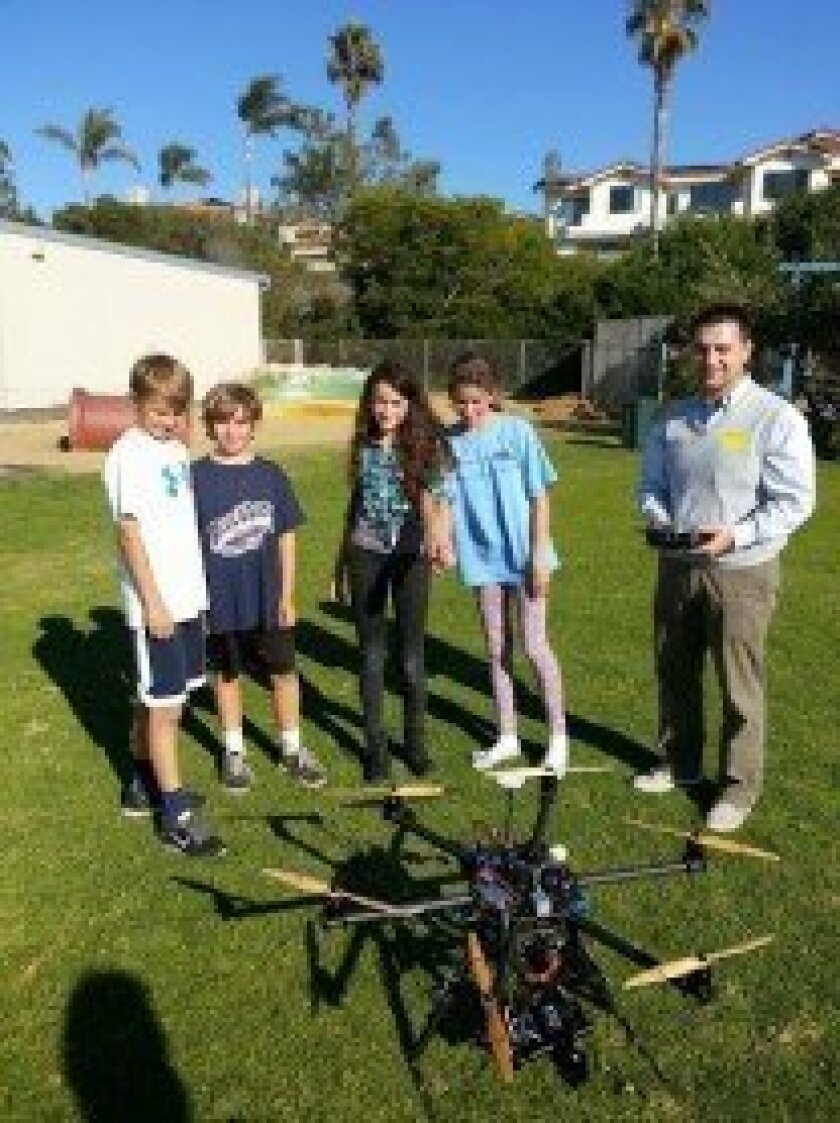 Del Mar Heights sixth graders (l-r) Hank, Julian, Lina, and Cleo. Sixth-grade students explored the creative process of Dragan Radoicic, a local architect, engineer and artist who uses ground-controlled flying machines to create stunning films for both artistic and professional purposes. Courtesy p
