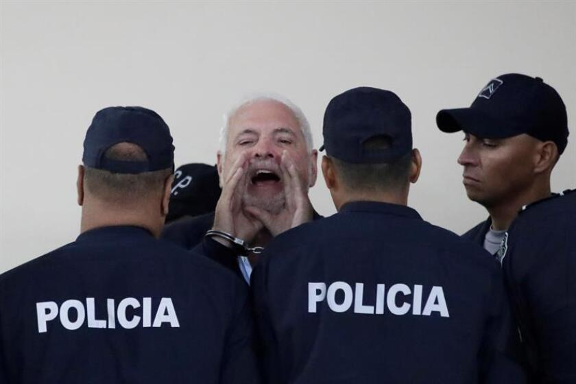 Former Panamanian President Ricardo Martinelli (C) yells during an espionage hearing in Panama City, Panama, 21 November 2018. The intermediate hearing for illegal wiretapping against Martinelli was suspended today and will be resumed on Thursday. EPA-EFE/BIENVENIDO VELASCO