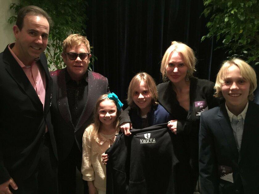 Greg Garbacz and Sir Elton John with Juliet, Matthew, Lauren and Luke Garbacz
