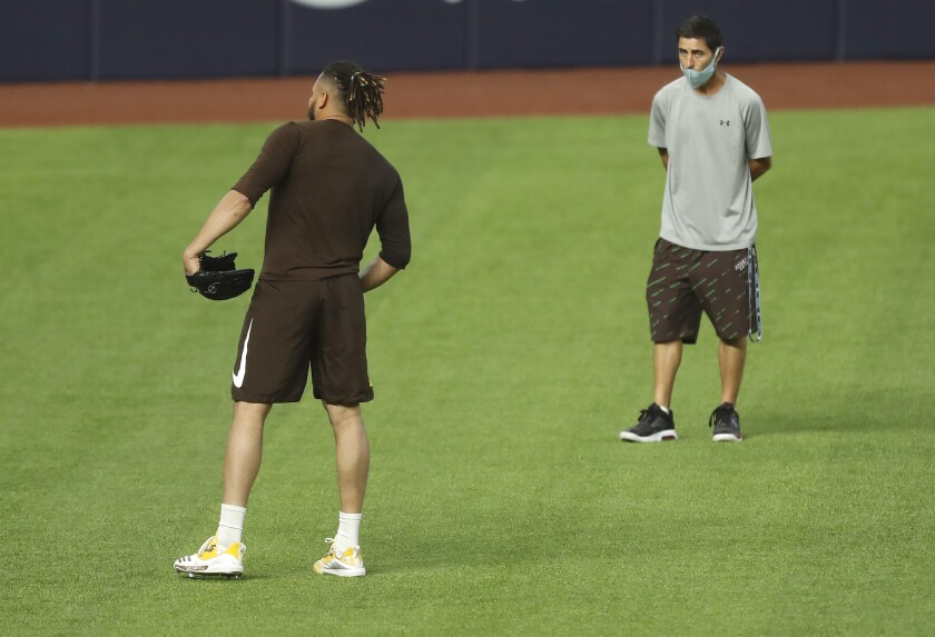 General Manager A.J. Preller of the San Diego Padres watches as Dinelson Lamet throws during a practice for the NLDS.
