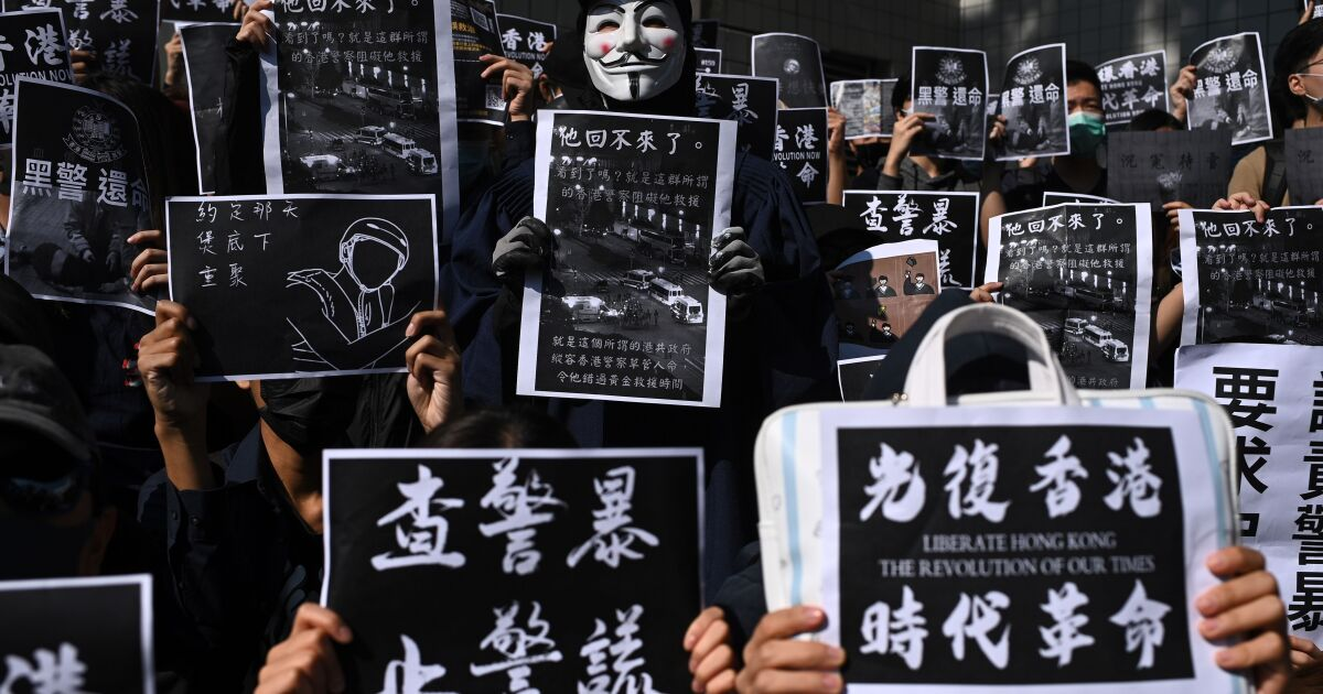 Hong Kong protesters call for 'revenge' after 22-year-old student dies in fall