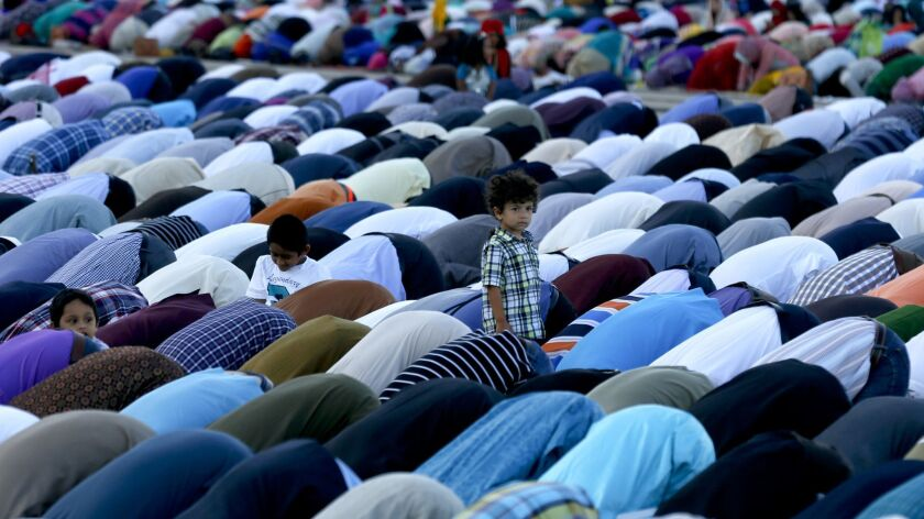 ANAHEIM ,CA SEPTEMBER 24, 2015: Orange County Muslims gather in prayer in the parking lot of Angel