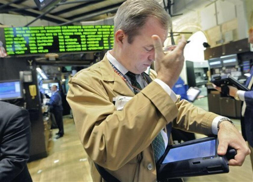 Trader David O'Day works on the floor of the New York Stock Exchange, Tuesday Dec. 2, 2008. (AP Photo/Richard Drew)