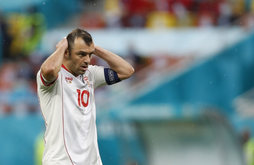 North Macedonia's Goran Pandev reacts after missing a chance to score during the Euro 2020 soccer championship group C match between Austria and Northern Macedonia at the National Arena stadium in Bucharest, Romania, Sunday, June 13, 2021. (AP Photo/Vadim Ghirda, Pool)