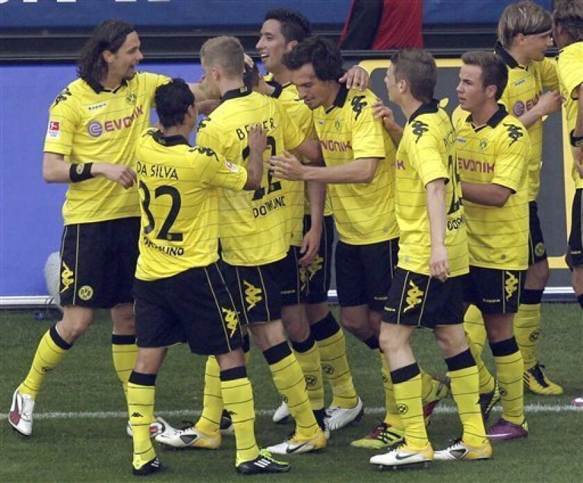 Dortmund's players celebrate their side's second goal during the German first division Bundesliga soccer match between Borussia Dortmund and 1.FC Nuremberg in Dortmund, Germany, Saturday, April 30, 2011. (AP Photo/Michael Sohn) NO MOBILE USE UNTIL 2 HOURS AFTER THE MATCH, WEBSITE USERS ARE OBLIGED TO COMPLY WITH DFL-RESTRICTIONS, SEE INSTRUCTIONS FOR DETAILS