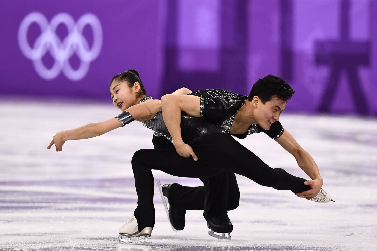 North Korea's Ryom Tae Ok (front) and North Korea's Kim Ju Sik hug after competing in the pair skating short program of the figure skating event during the Pyeongchang 2018 Winter Olympic Games at the Gangneung Ice Arena in Gangneung on February 14, 2018. / AFP PHOTO / Roberto SCHMIDTROBERTO SCHMIDT/AFP/Getty Images ** OUTS - ELSENT, FPG, CM - OUTS * NM, PH, VA if sourced by CT, LA or MoD **