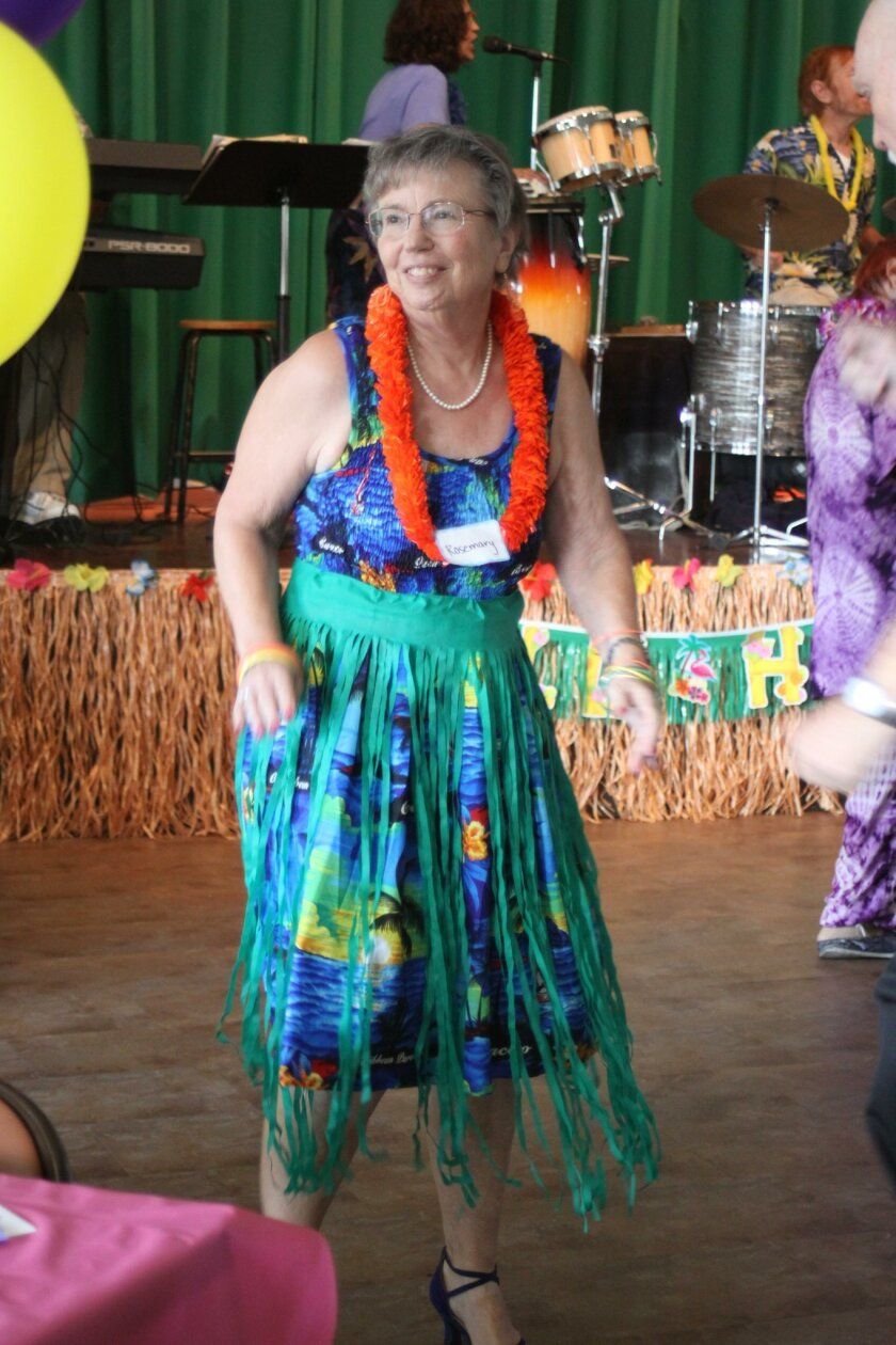 Rosemary Benefield goes Hawaiian in her lei and grass skirt.