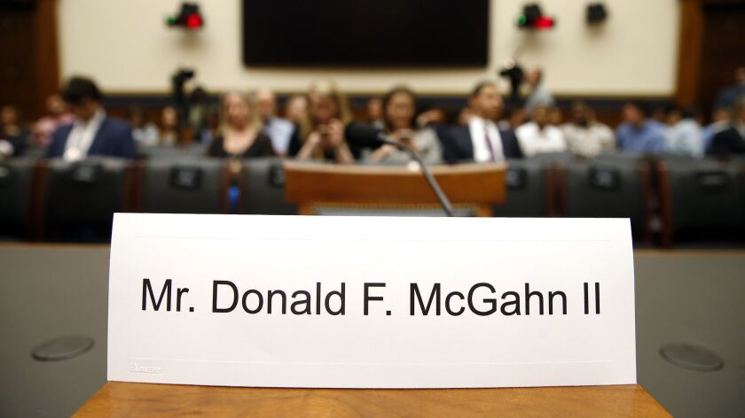 A name placard is displayed for former White House Counsel Don McGahn, who is not expected to appear