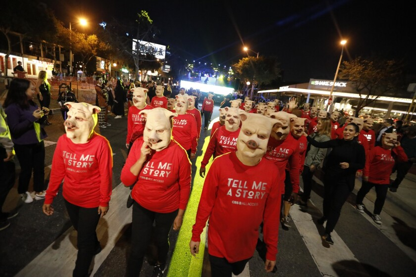 WEST HOLLYWOOD, CA ? OCTOBER 31, 2018 - - A group dressed in pigs masks join the thousands of costum
