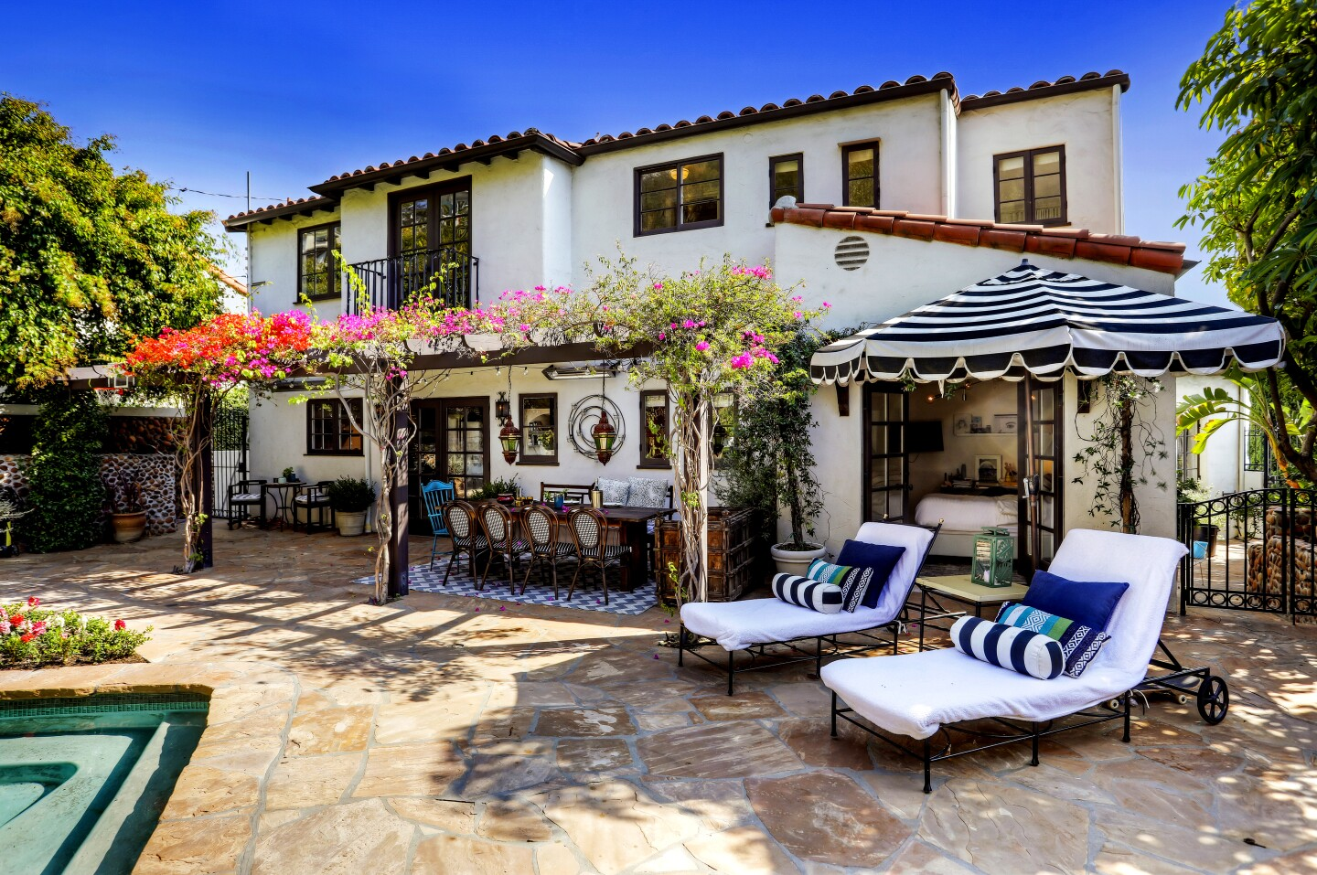"""""""Schitt's Creek"""" actor Dan Levy has bought a Spanish-style home in Los Feliz for $4.13 million. Set high up from the street, the house features 3,177 square feet of updated interior, original stonework and a chef's kitchen. Stonework and a hand-forged staircase in the entry are original. French doors open onto a dining patio in the backyard."""