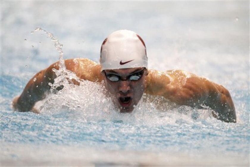 Bobby Bollier takes a breath on his way to winning the men's 100-meter butterfly event at the Indianapolis Grand Prix swimming meet in Indianapolis, Saturday, March 31, 2012.  (AP Photo/Michael Conroy)