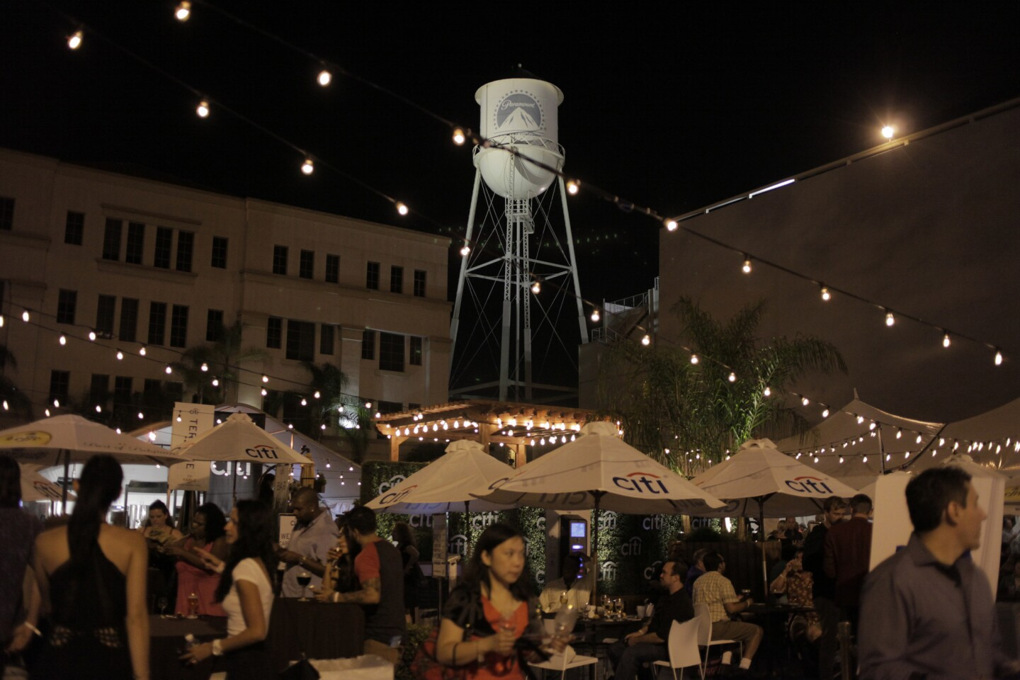 The Paramount water tower overlooks the outdoor lounge area, where guests sample food dishes and drinks.