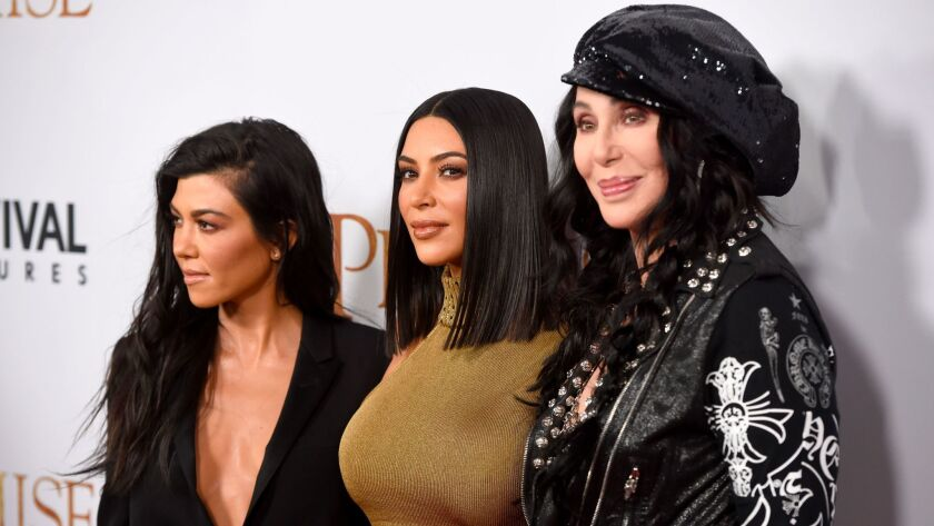 """Kourtney Kardashian, from left, Kim Kardashian and Cher attend the premiere of """"The Promise"""" in Los Angeles."""